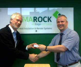 Dr Andrew Smith, Principal Consultant at Ceram presents Stewart Porteous of Permarock with the portable media player